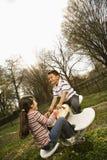 Rapariga e menino que jogam no balanço fotos de stock royalty free