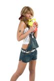 Rapariga em shorts das calças de brim Fotos de Stock Royalty Free