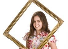 Rapariga em um frame Imagem de Stock