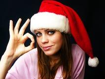 Rapariga em um tampão vermelho Imagens de Stock Royalty Free