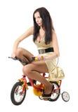 Rapariga em uma bicicleta das crianças Fotos de Stock Royalty Free