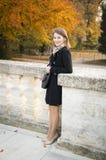 Rapariga feliz bonita em um parque do outono Imagens de Stock Royalty Free