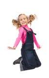 Rapariga feliz de salto Fotografia de Stock Royalty Free