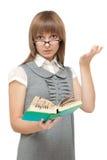 A rapariga lê o inglês e é espantada Fotos de Stock Royalty Free