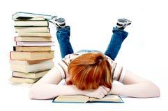 A rapariga leu o livro no branco Imagem de Stock Royalty Free