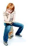 A rapariga leu o livro no branco Fotografia de Stock Royalty Free