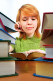 A rapariga leu o livro no branco Fotos de Stock