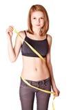 A rapariga mede uma cintura Imagens de Stock Royalty Free