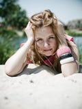 Rapariga na areia Foto de Stock