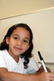 Rapariga na escola fotos de stock