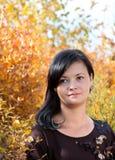 Rapariga na floresta do outono imagens de stock