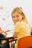 Rapariga na sala de aula imagens de stock royalty free