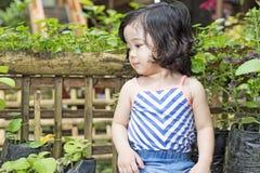 Rapariga no jardim Fotografia de Stock
