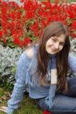 Rapariga no jardim de flor Fotos de Stock Royalty Free