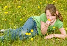 Rapariga no prado da mola Imagem de Stock