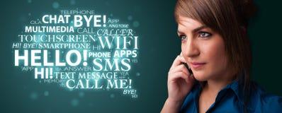 Rapariga que chama pelo telefone com nuvem da palavra Imagens de Stock Royalty Free
