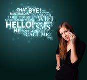 Rapariga que chama pelo telefone com nuvem da palavra Fotos de Stock Royalty Free