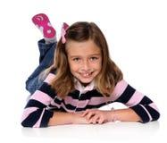 Rapariga que coloca no assoalho Foto de Stock