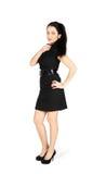 Rapariga que desgasta o vestido preto curto Imagem de Stock