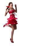 A rapariga que desgasta um vestido vermelho é dança isolado Imagem de Stock Royalty Free