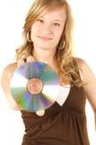 Rapariga que prende um Cd Fotografia de Stock