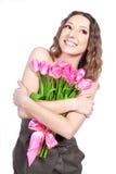 Rapariga que prende um ramalhete das flores Imagens de Stock