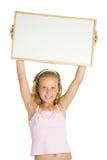 Rapariga que prende uma bandeira branca fotografia de stock royalty free