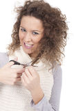 Rapariga que tenta cortar seu cabelo Imagem de Stock Royalty Free