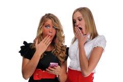 Raparigas com telefone de pilha Imagem de Stock