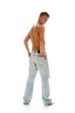 Rapaz nas calças de brim Imagem de Stock