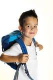 Rapaz pequeno alegre com a trouxa pronta para a escola Foto de Stock Royalty Free