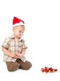 Rapaz pequeno bles desgastando de um chapéu de Santa Fotos de Stock