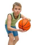Rapaz pequeno com basquetebol Imagens de Stock