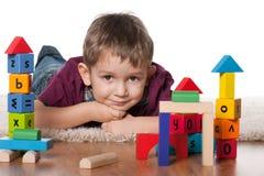 Rapaz pequeno com brinquedos Imagem de Stock Royalty Free