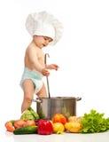 Rapaz pequeno com concha, caçarola, e vegetais Imagem de Stock