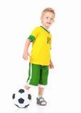 Rapaz pequeno com a criança do futebol ball Fotografia de Stock Royalty Free