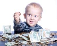 Rapaz pequeno com dinheiro Fotos de Stock Royalty Free
