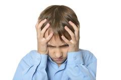 Rapaz pequeno com dor de cabeça Foto de Stock Royalty Free