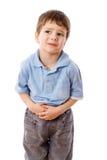 Rapaz pequeno com dor de estômago Fotografia de Stock