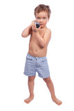 Rapaz pequeno com dumbbell Fotografia de Stock Royalty Free
