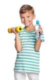 Rapaz pequeno com dumbbells Imagem de Stock