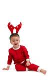 Rapaz pequeno com a faixa do cabelo da rena Foto de Stock