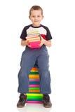 Rapaz pequeno com livros imagem de stock royalty free