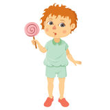Rapaz pequeno com pirulito Imagem de Stock Royalty Free