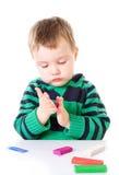 Rapaz pequeno com plasticine imagens de stock royalty free