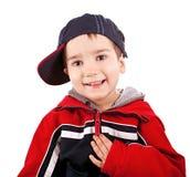 Rapaz pequeno com tampão Fotografia de Stock Royalty Free