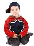 Rapaz pequeno com telefone de pilha Fotografia de Stock Royalty Free