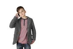 Rapaz pequeno com telefone de pilha Fotos de Stock Royalty Free