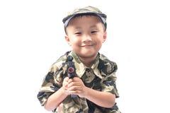 Rapaz pequeno com terno do soldado Fotografia de Stock