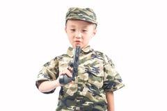 Rapaz pequeno com terno do soldado Foto de Stock Royalty Free